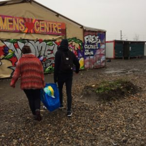 Carrying supplies to the women centre